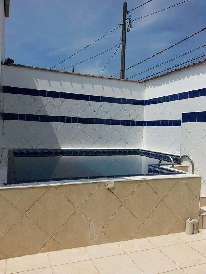 <Casa deliciosa com 6 suites e piscina  na praia de Enseada Guaruja